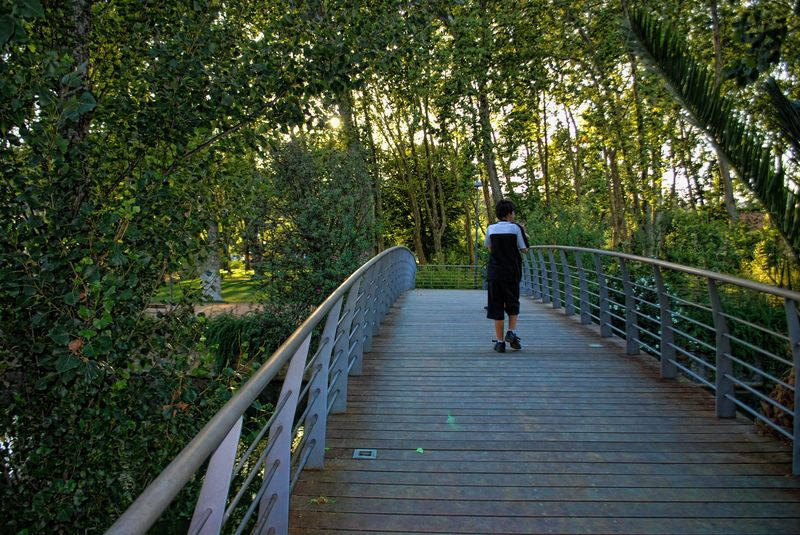 Crossing the Bridge to the Island of Mouchão Park in the City of Tomar in Portugal