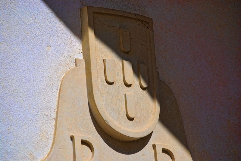 Portugal's coat of arms on a parish building in the City of Tomar