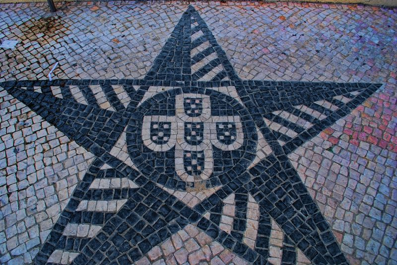 Star and Portugal's coat of arms on a pathway in the City of Tomar