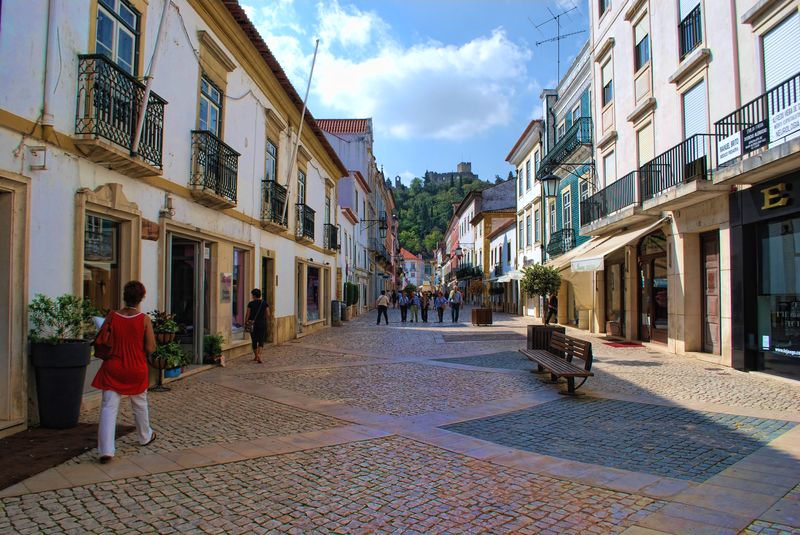 People walking at Corredoura in Tomar, Portugal