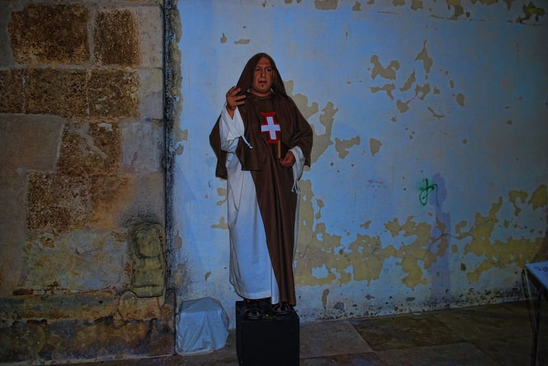 Human statue of a Friar of the Order of Christ  in the City of Tomar in Portugal