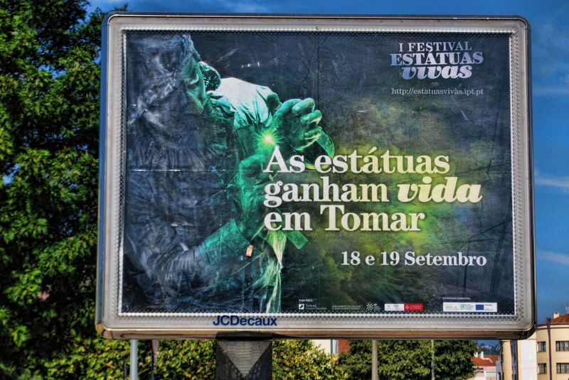 Road billboard in the City of Tomar of the Festival of the Human Statues