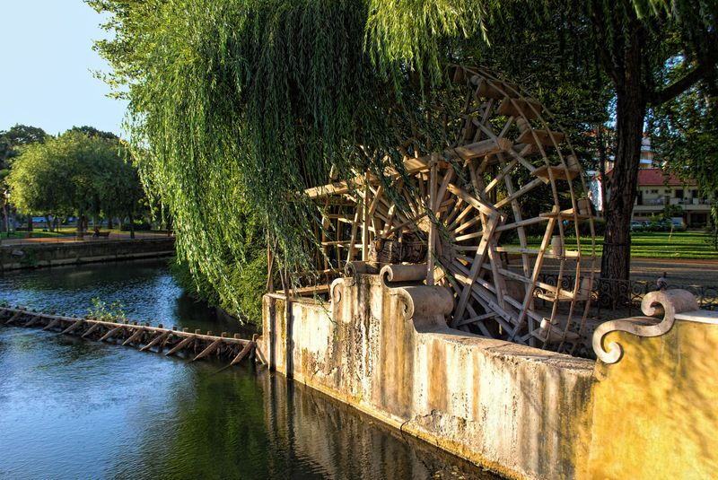 Wooden water wheel at the Island of Mouchão Park in the City of Tomar