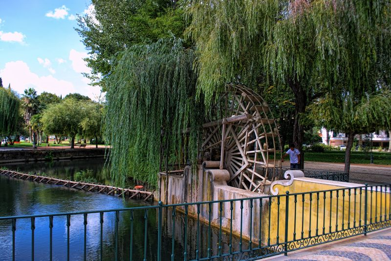 Wooden water wheel at Nabão River and Mouchão Park in the City of Tomar