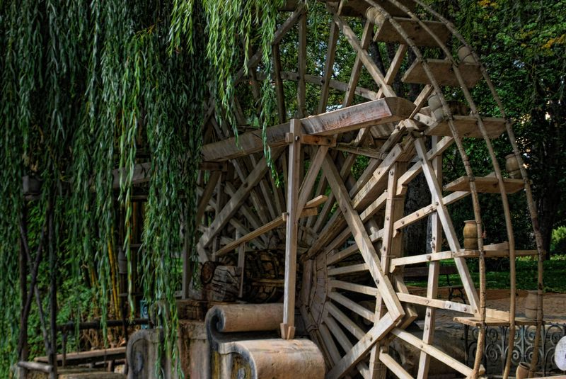 Wooden water wheel and willow tree in Tomar, Portugal