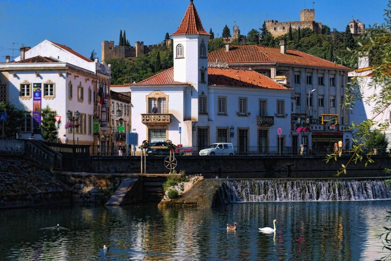 Falls of Nabão River and the Castle of the Knights Templar in Tomar