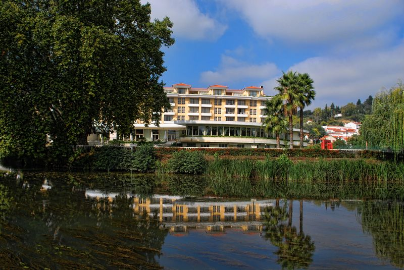 Water reflections of Templars Hotel at Nabão River in the City of Tomar