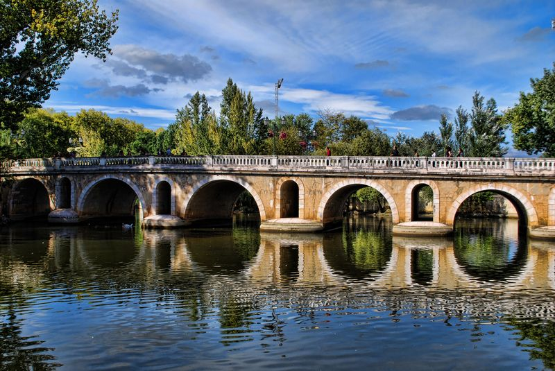 Old Bridge water reflections in the City of Tomar in Portugal