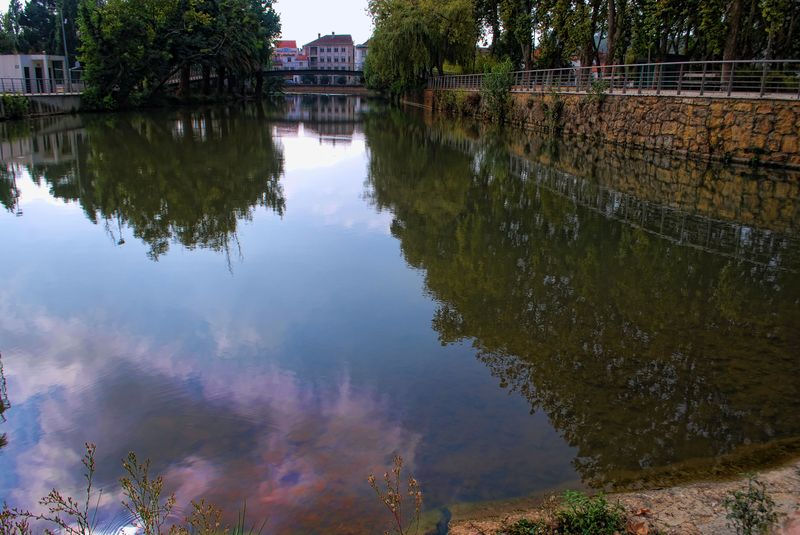 River reflections from a dam at Mouchao Park in the City of Tomar in Portugal