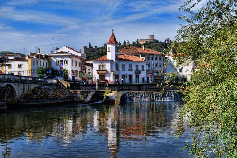 Reflections of Vieira Guimarães House at Nabão River in the City of Tomar