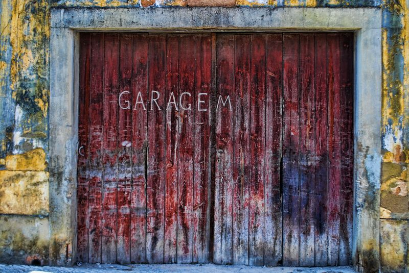 Decayed garage door in the City of Tomar in Portugal