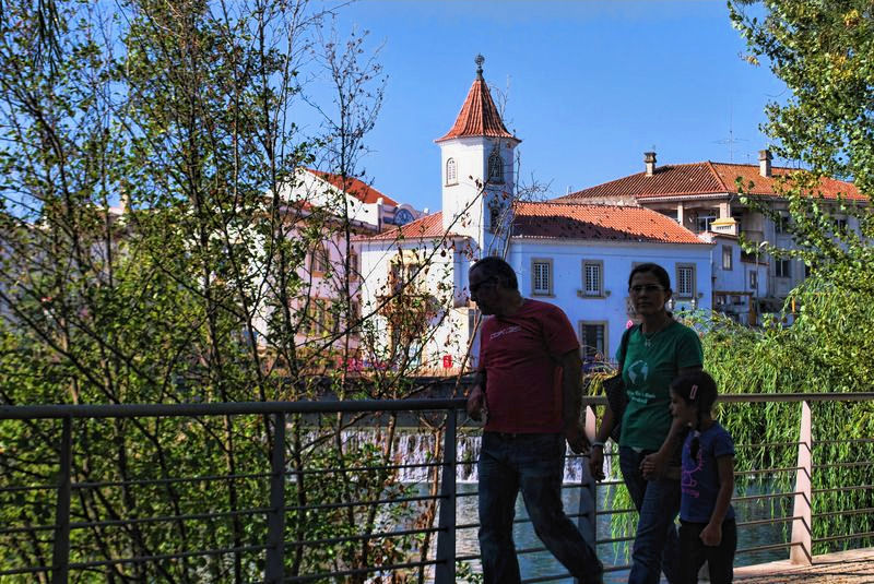 Couple and daughter around Nabão River in the City of Tomar in Portugal