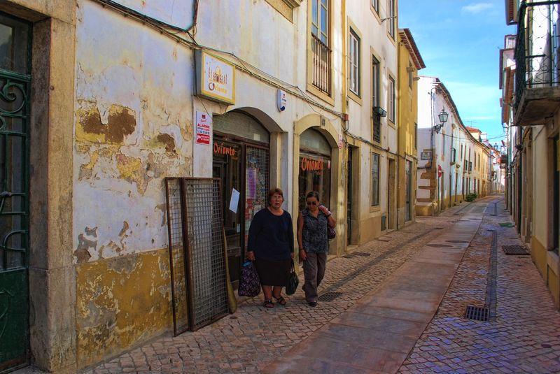 Ladies in an old street of the City of Tomar in Portugal