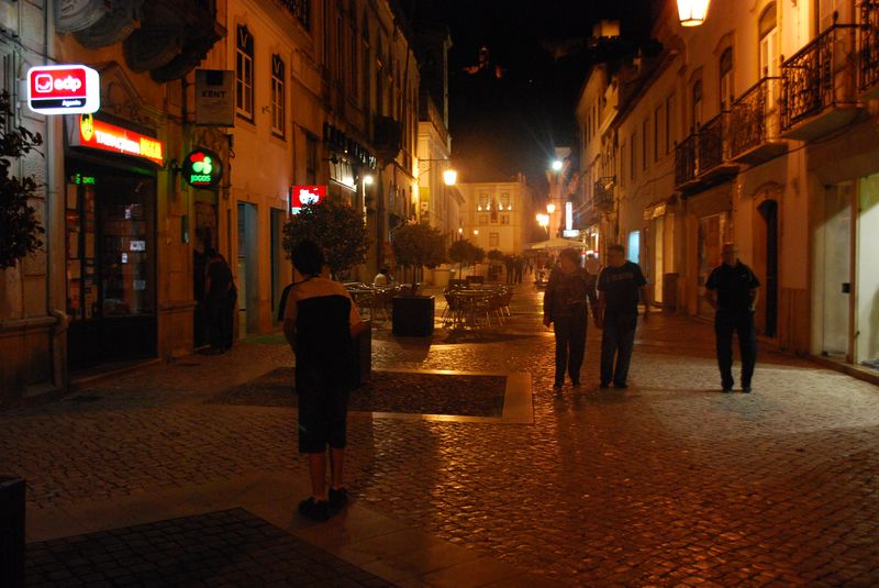 People at Rua Serpa Pinto in the City of Tomar in Portugal