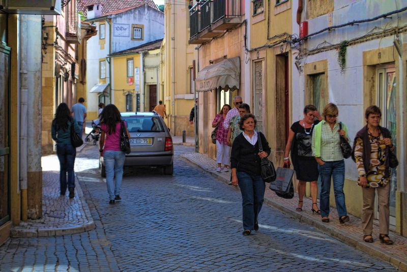 Portuguese people walking in the street known as Rua do Cinema in Tomar