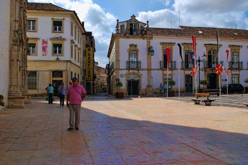 People walking at Praça da República in the City of Tomar in Portugal