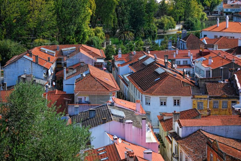 Rooftops around Mouchão Park and Nabão River in the City of Tomar