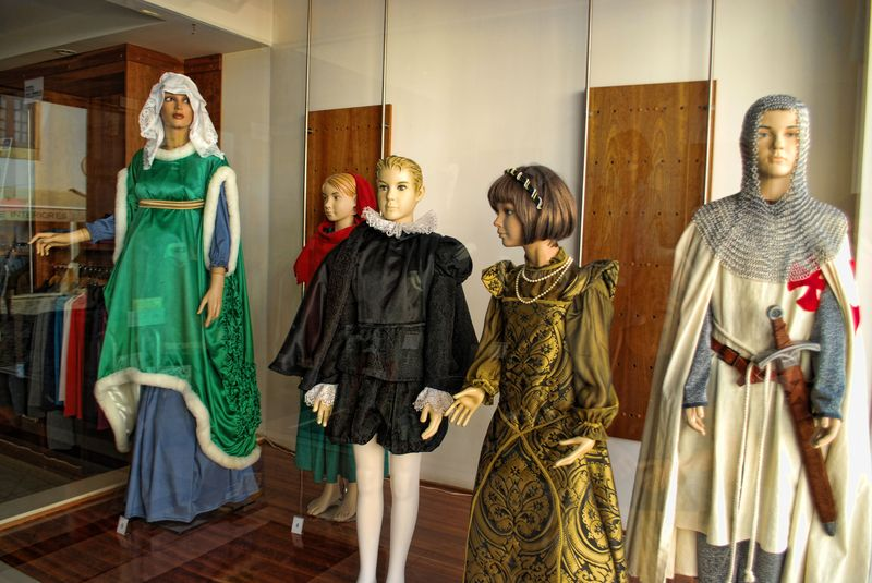 Show window with mannequins attired with old costumes