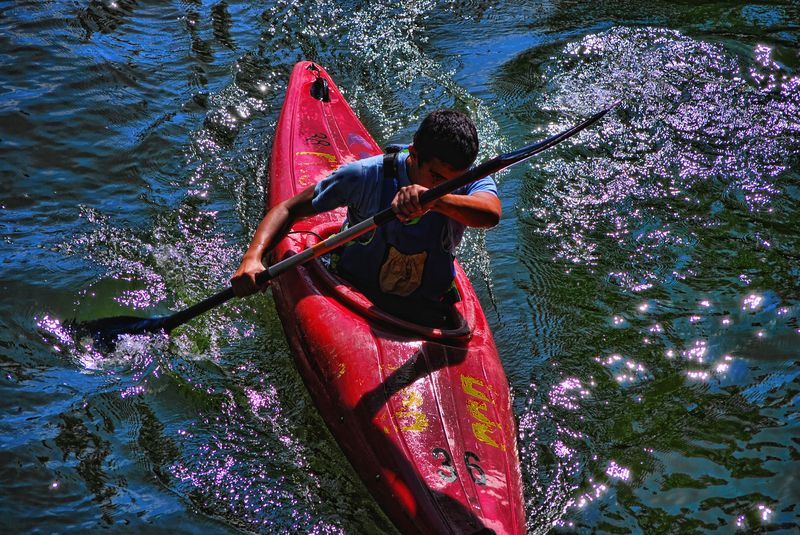 Energetic paddling of a canoe at Nabão River in the City of Tomar
