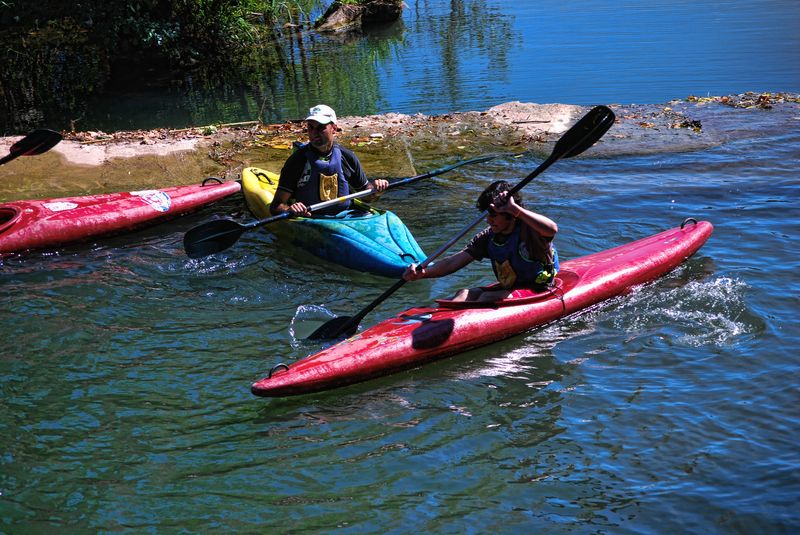 Canoe riders at Nabão River in the City of Tomar in Portugal
