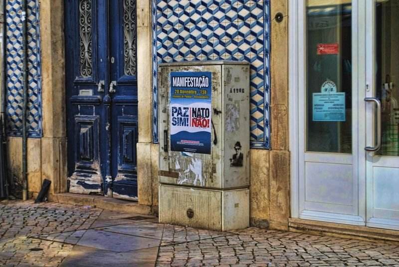 Tiles at Pinheiro Pharmacy and NATO poster in the City of Tomar