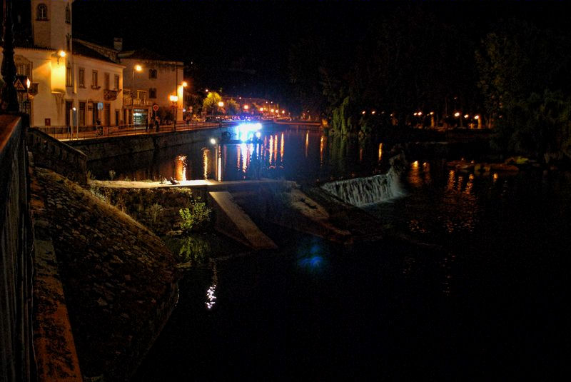 Nabão River at night from the Old Bridge of the City of Tomar in Portugal