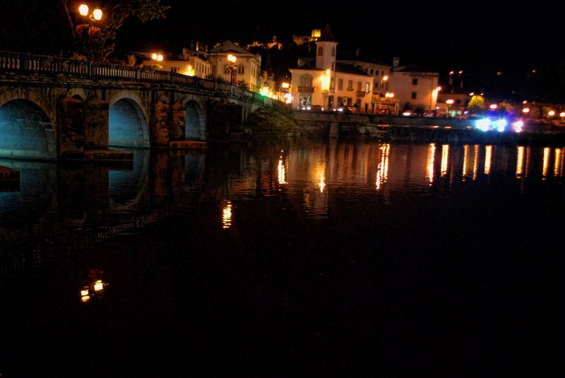 Old bridge and the town and Castle of Tomar at night
