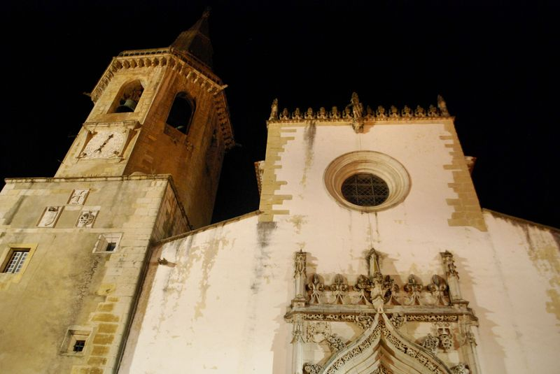 Illuminated tower and facade of the Church of São João Baptista in the City of Tomar
