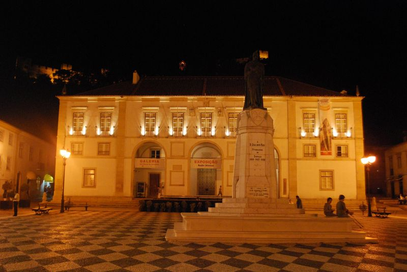 The Town Council building at night and the statue of Gualdim Pais in the City of Tomar