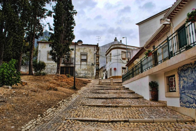 Cobblestone lane at Rua da Cascalheira in the City of Tomar in Portugal