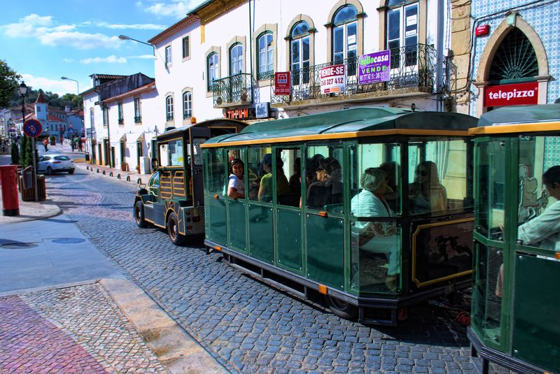 Tourist train at Rua Marquês de Pombal in the City of Tomar in Portugal