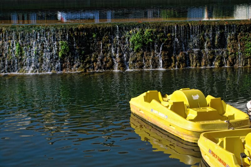 Yellow paddle boats at Nabão River in Tomar, Portugal