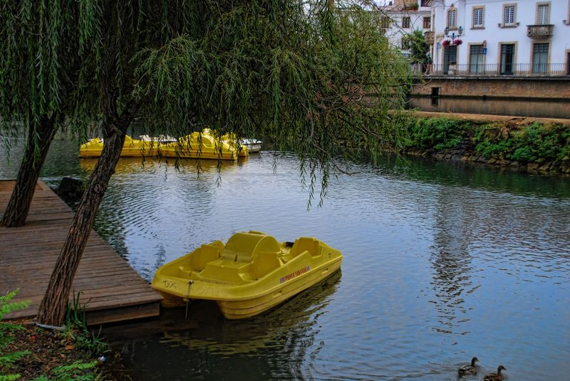 Yellow paddle boats at Nabão River in the City of Tomar