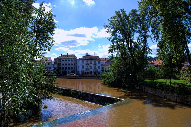 Muddy waters at Nabão River in the City of Tomar in Portugal