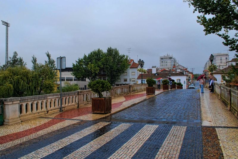 Old Bridge in the City of Tomar in a wet day