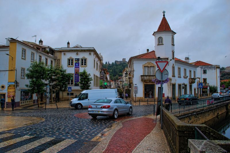 Raining in the City of Tomar with cobblestones pathways and roads