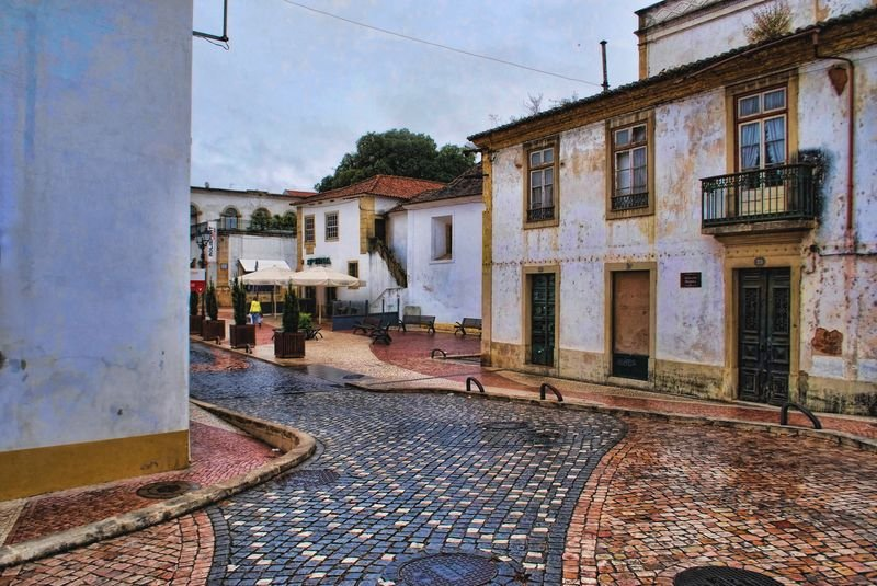 Wet cobblestone pavement at Rua Marquês de Pombal in the City of Tomar