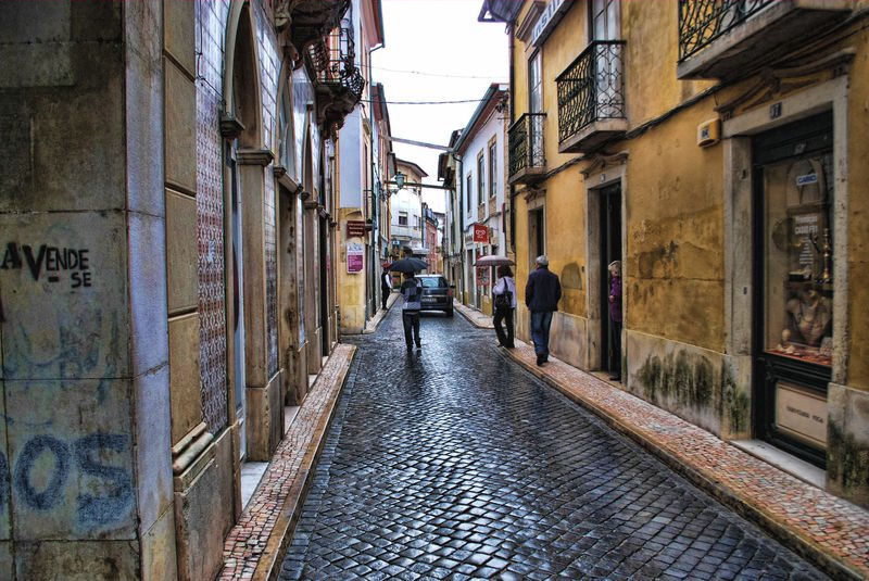 Cobblestone street in a wet day at Rua Infantaria 15 in the City of Tomar
